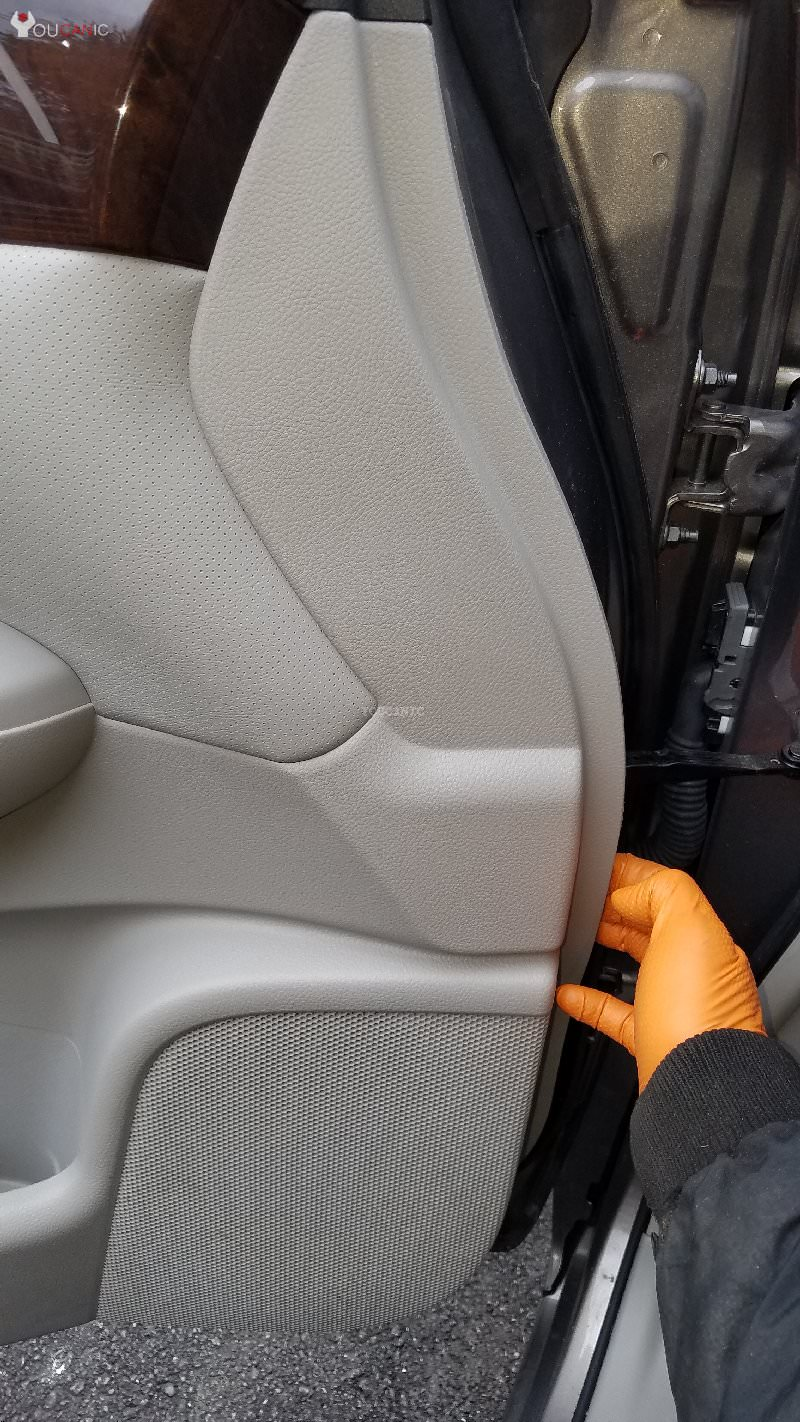 remove Nissan door panel to access the side view mirror